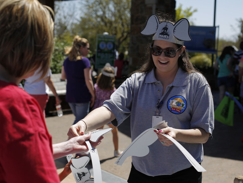 Zoo worker Deanna Dydynski passes out elephant ears to zoo guests during Malee's Second Birthday Bash at the Oklahoma City Zoo, Sunday, April 14, 2013.  Photo by Garett Fisbeck, For The Oklahoman