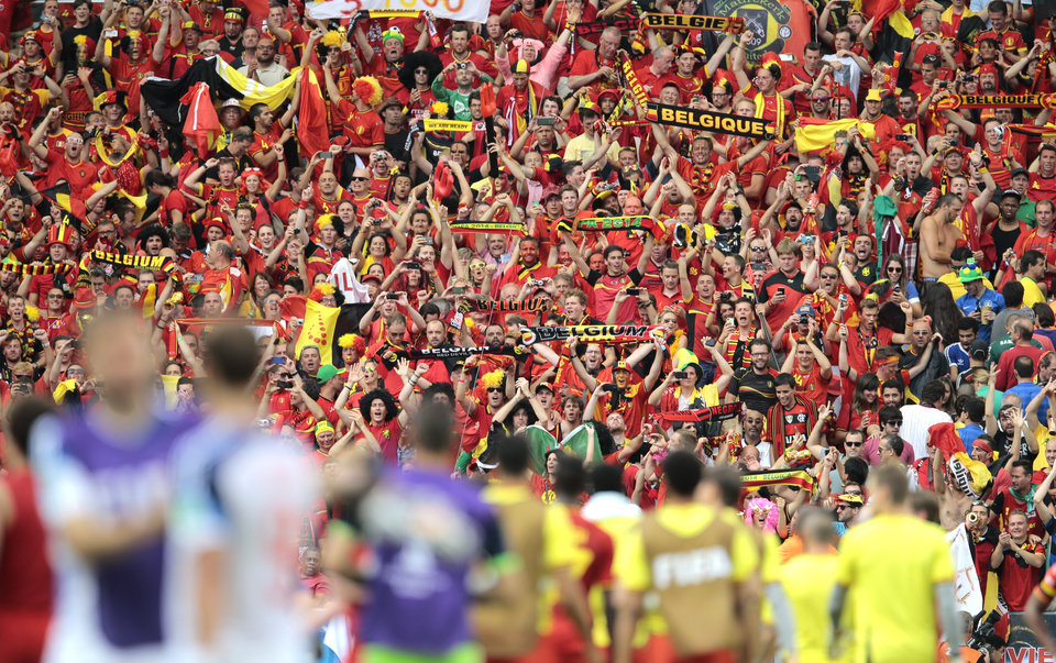 Photo - Belgium supporters celebrate in the stands after the group H World Cup soccer match between Belgium and Russia at the Maracana Stadium in Rio de Janeiro, Brazil, Sunday, June 22, 2014. Belgium won the match 1-0. (AP Photo/Ivan Sekretarev)
