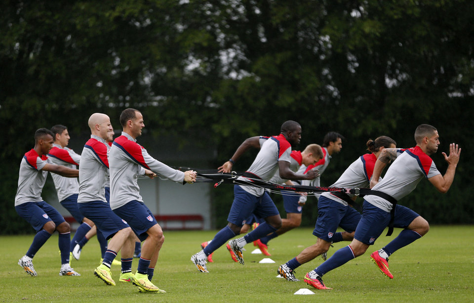 Photo - United States players work on resistance exercises during a training session at the Sao Paulo FC training center in Sao Paulo, Brazil, Tuesday, June 10, 2014. The U.S. will play in group G of the 2014 soccer World Cup. (AP Photo/Julio Cortez)