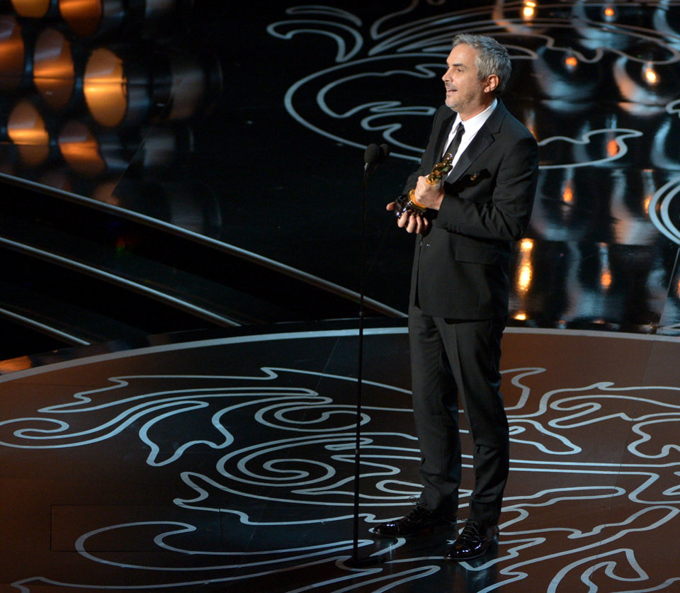 Photo - Alfonso Cuaron accepts the award for best director of the year for