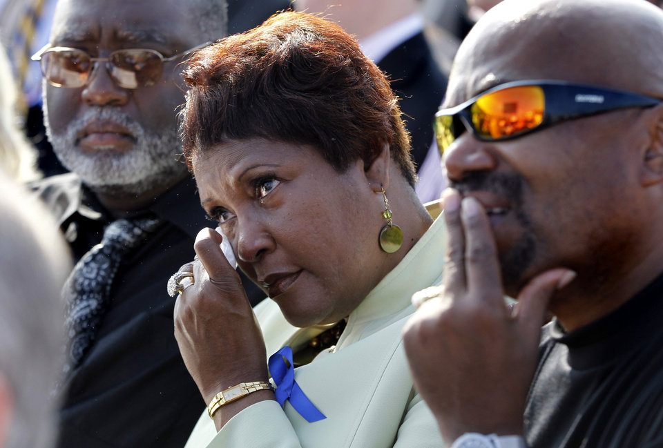 An unidentified woman wipes away a tear during the playing of Amazing Grace during a ceremony marking the 10th anniversary of the September 11 attacks at the Pentagon in Washington, Sunday, Sept. 11, 2011. (AP Photo/Charles Dharapak)