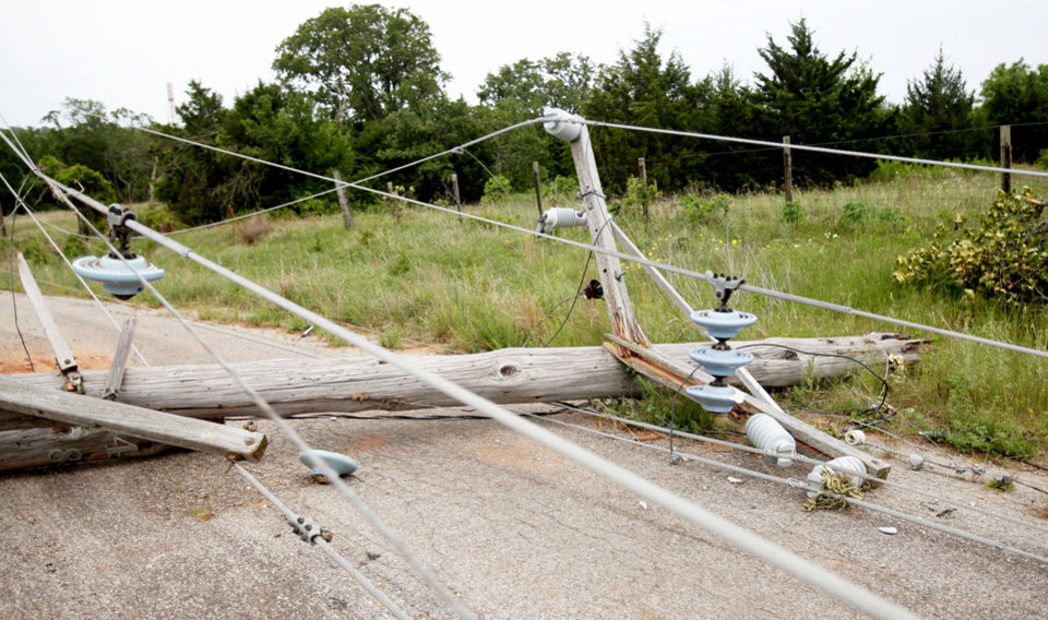 A power line lies across a road Wednesday near the Lake Stanley Draper water treatment plant in Oklahoma City. Photo by Sarah Phipps, The Oklahoman
