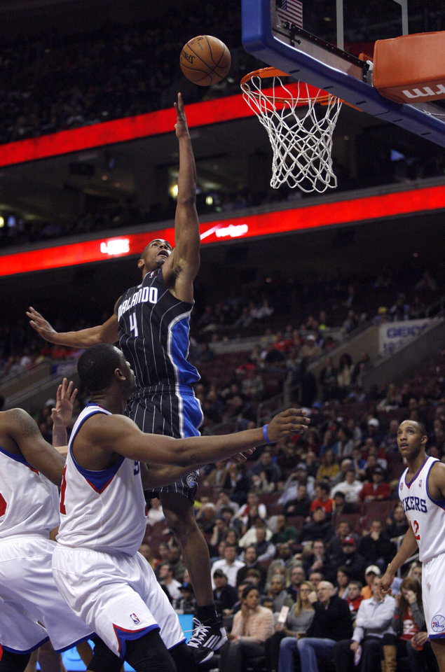 Orlando Magic\'s Arron Affialo (4) shoot against the Philadelphia 76ers in the first half of an NBA basketball game, Tuesday, Feb. 26, 2013, in Philadelphia. (AP Photo/H. Rumph Jr)