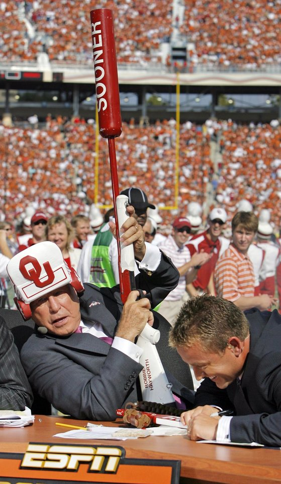 Photo - UNIVERSITY OF OKLAHOMA / OU / COLLEGE FOOTBALL / TEXAS: Kirk Herbstreit, right, laughs after Lee Corso fired off a RUF/NEKS shotgun when he picked OU to win against Texas on ESPN's College Gameday before the college football game between the University of Oklahoma Sooners (OU) and University of Texas Longhorns (UT) in the Red River Rivalry on Saturday, Oct. 11, 2008, at the Cotton Bowl, in Dallas, Texas. UT won, 45-35. BY NATE BILLINGS, THE OKLAHOMAN  ORG XMIT: KOD