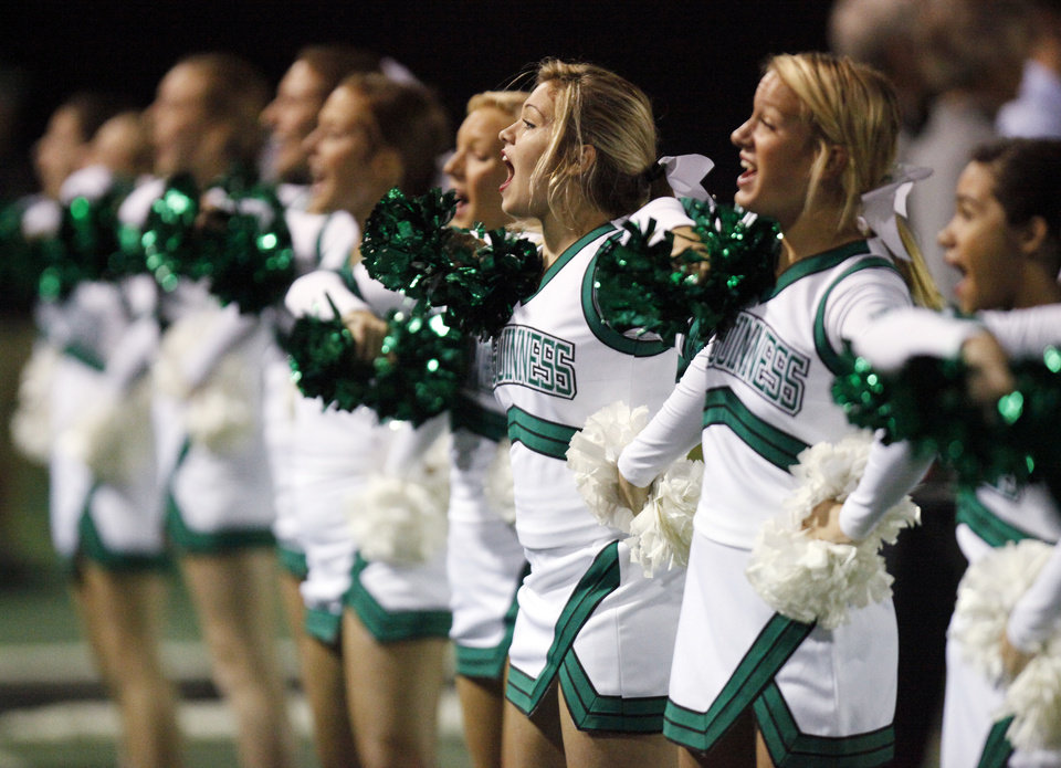 Bishop McGuinness cheerleaders encourage their team during a high school football game between Millwood and Bishop McGuinness at Bishop McGuinness Catholic High School in Oklahoma City, Friday, Sept. 16, 2011. Photo by Nate Billings, The Oklahoman