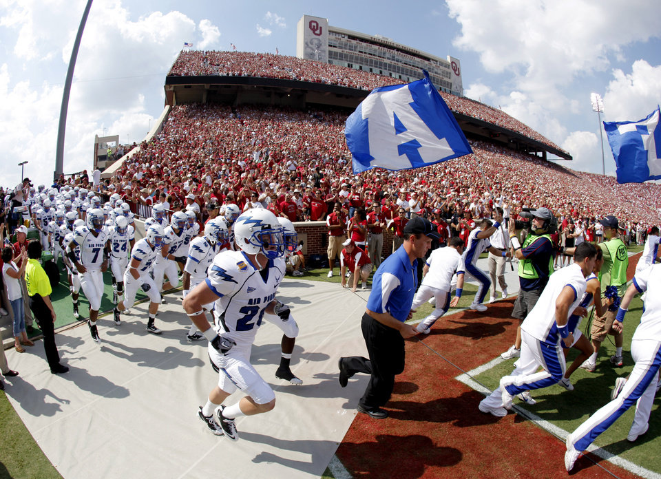 The Air Force team takes the field before the college football game between the University of Oklahoma Sooners (OU) and Air Force (AF) at the Gaylord Family-Oklahoma Memorial Stadium on Saturday, Sept. 18, 2010, in Norman, Okla.   Photo by Bryan Terry, The Oklahoman