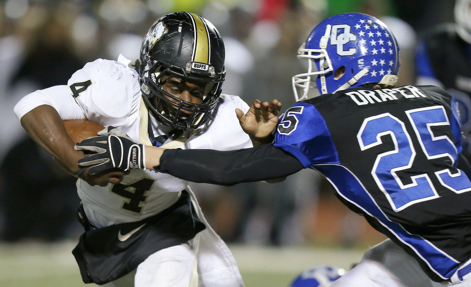Photo - McAlester's Jarome Smith fights off Deer Creek's Chad Draper during a high school football playoff game at Deer Creek, Friday, Nov. 16, 2012. Photo by Bryan Terry, The Oklahoman