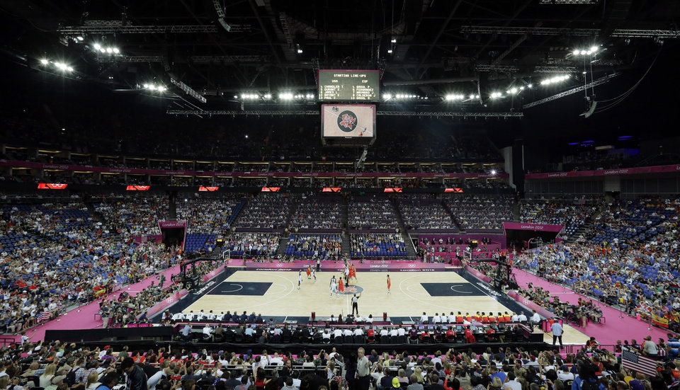 The United States and Spain tip-off for the start of the men's gold medal basketball game at the 2012 Summer Olympics, Sunday, Aug. 12, 2012, in London. (AP Photo/Matt Slocum)