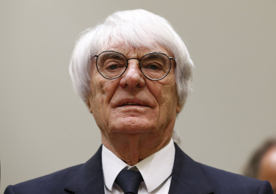 Photo - F1 CEO Bernie Ecclestone arrives in the  court in Munich, southern Germany, Thursday, April 24, 2014. Ecclestone is charged with bribery and incitement to breach of trust