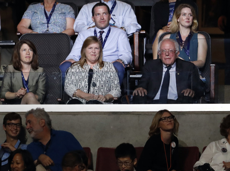 Photo - Former Democratic presidential candidate, Sen. Bernie Sanders, I-Vt., center right, sits besides his wife Jane during the second day of the Democratic National Convention in Philadelphia , Tuesday, July 26, 2016. (AP Photo/Paul Sancya)