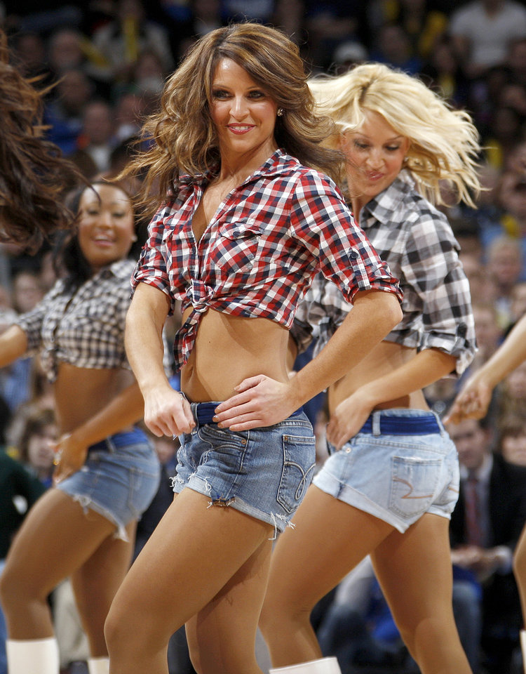 The Thunder Girls dance team performs during the NBA basketball game between the Oklahoma City Thunder and Portland Trail Blazers at Chesapeake Energy Arena in Oklahoma City, Tuesday, Jan. 3, 2012. Photo by Nate Billings, The Oklahoman