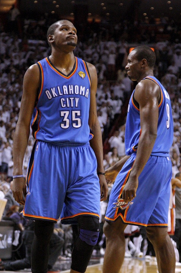 Photo - Oklahoma City's Kevin Durant (35) reacts beside Serge Ibaka (9) during Game 4 of the NBA Finals between the Oklahoma City Thunder and the Miami Heat at American Airlines Arena, Tuesday, June 19, 2012. Oklahoma City lost 104-98.  Photo by Bryan Terry, The Oklahoman
