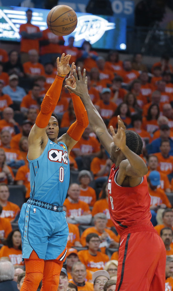 Photo - Oklahoma City's Russell Westbrook (0) shoots a 3-pointer over Al-Farouq Aminu (8) during Game 3 in the first round of the NBA playoffs between the Portland Trail Blazers and the Oklahoma City Thunder at Chesapeake Energy Arena in Oklahoma City, Friday, April 19, 2019. Oklahoma City won 120-108. Photo by Bryan Terry, The Oklahoman