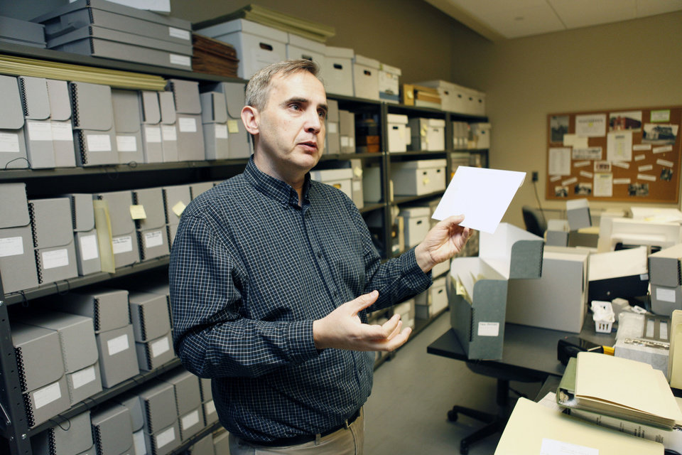 Chad Williams, deputy director of the Oklahoma Historical Society's research division, has many favorites in the collection of millions of Oklahoma historical images. PHOTO BY PAUL HELLSTERN, THE OKLAHOMAN