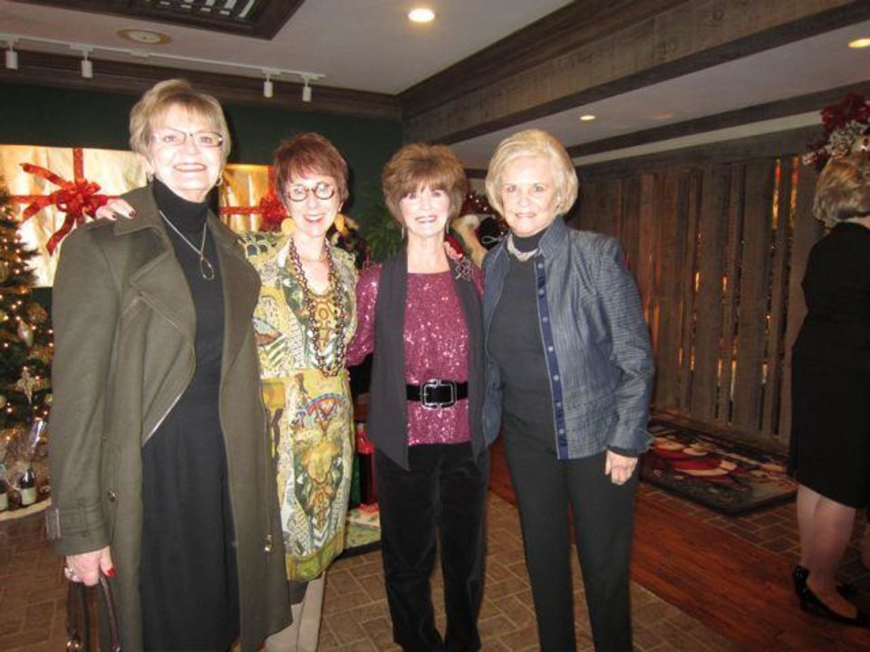 DeDe Benham, Annie Bohanon, Barbara Brou and Pam Smith talk at the party. Brou was one of the hostesses. (Photo by Helen Ford Wallace).