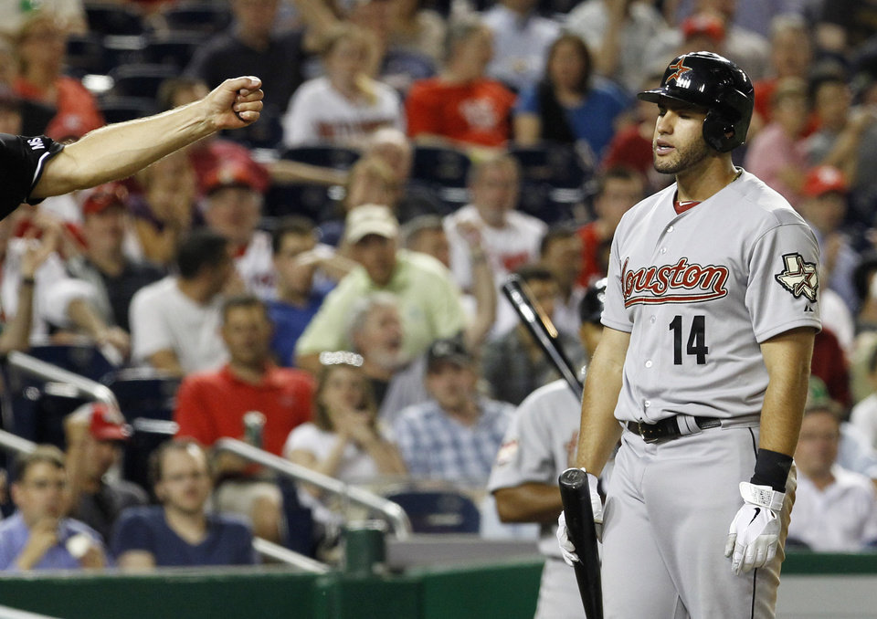 Houston Astros' J.D. Martinez (14) reacts after striking out swinging against Washington Nationals relief pitcher Ryan Mattheus during the seventh inning of a baseball game in Washington, Monday, April 16, 2012. The Nationals beat the Astros 6-3. (AP Photo/Ann Heisenfelt) ORG XMIT: NAT108
