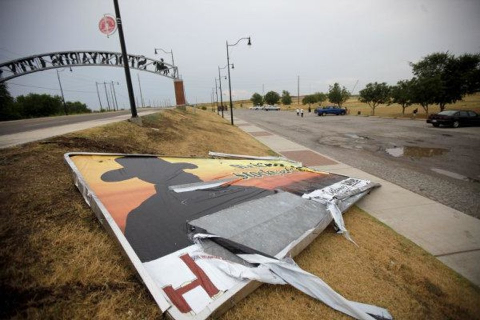 A sign lies on the ground just past the gateway to Stockyards City after a storm passed through the Oklahoma CIty area on Wednesday, August 3, 2011. Photo by Bryan Terry, The Oklahoman ORG XMIT: KOD