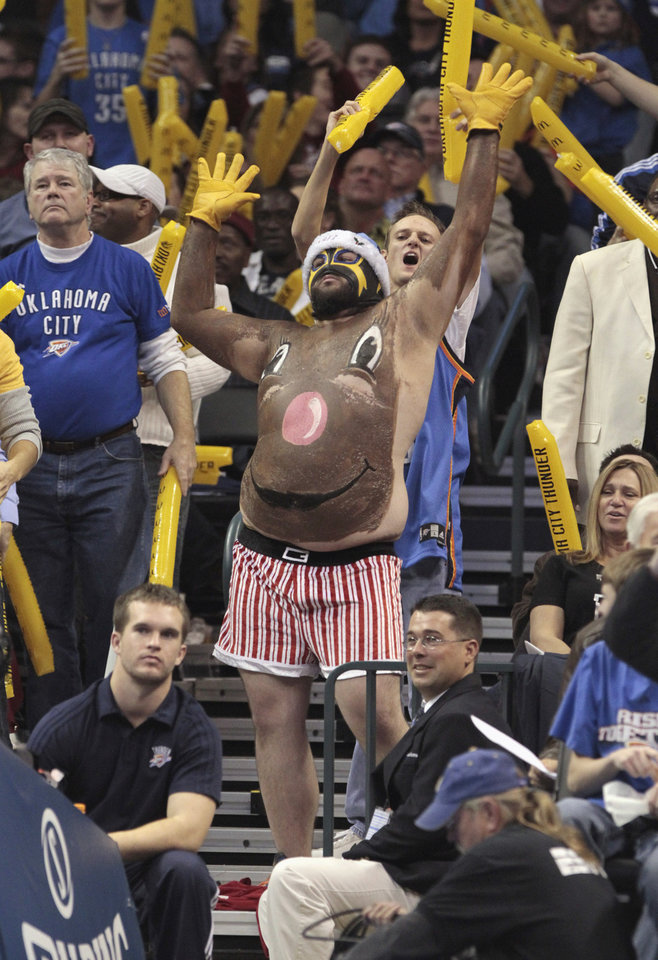A fan with a painted chest and red and white underwear tries to distract an Orlando free-throw shooter in the second half as the Oklahoma City Thunder defeat the Orlando Magic 97-89 in NBA basketball at the Chesapeake Energy Arena on Sunday, Dec. 25, 2011, in Oklahoma City, Okla. Photo by Steve Sisney, The Oklahoman