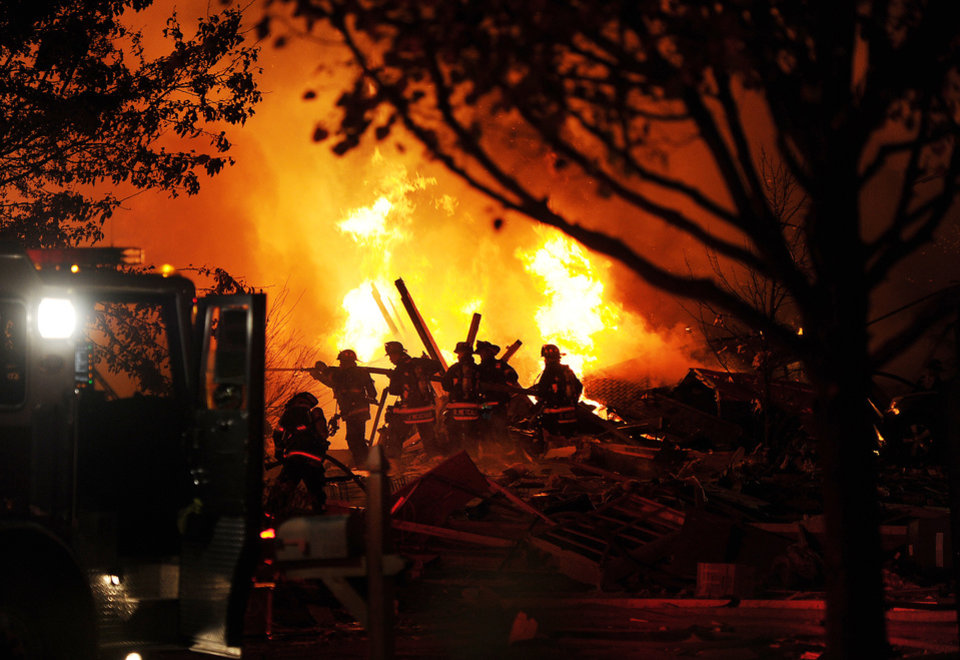 Photo -   Authorities say a loud explosion has leveled a home in Indianapolis and set four others ablaze in a neighborhood, causing several injuries. Capt. Rita Burris with the Indiana Fire Department told The Associated Press that firefighters are still working to put out the flames after the explosion around 11 p.m. Saturday Nov. 10, 2012. (AP Photo/The Indianapolis Star, Matt Kryger)