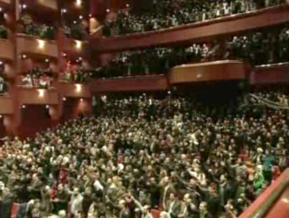 Photo - In this image taken from video obtained from Syrian State Television, which has been authenticated based on its contents and other AP reporting, people listen to Syrian President Bashar Assad's speech, not pictured, at the Opera House in central Damascus, Syria, Sunday, Jan. 6, 2013. Syrian President Bashar Assad on Sunday outlined a new peace initiative that includes a national reconciliation conference and a new government and constitution but demanded regional and Western countries stop funding and arming rebels first. (AP Photo/Syrian State Television via AP video)