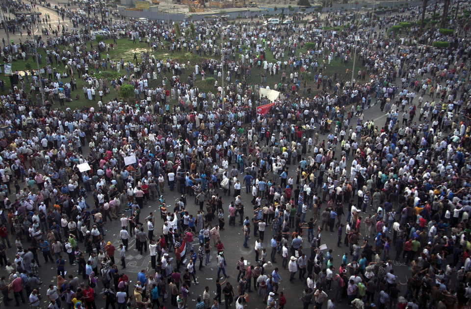 Protesters gather in Tahrir square in Cairo, Egypt, Friday, Oct. 12, 2012. Thousands of supporters and opponents of Egypt's new Islamist president clashed in Cairo's Tahrir Square on Friday, hurling stones and concrete and swinging sticks at each other in the first such violence since Mohammed Morsi took office more than three months ago.(AP Photo/Khalil Hamra)
