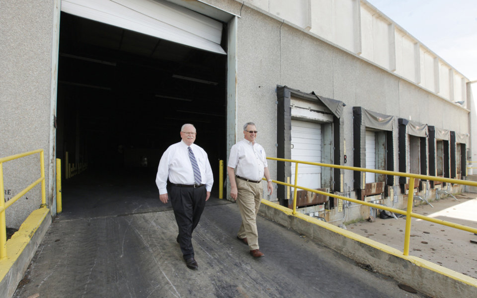 Photo - Randy Lacey, industrial broker and a vice president for Newmark Grubb Levy Strange Beffort, and Austin Rose, president and CEO of Producers Cooperative Oil Mill, at the former Bridgestone/Firestone Dayton Tire plant, 2500 S Council Road.    PHOTOs BY PAUL B. SOUTHERLAND, THE OKLAHOMAN  PAUL B. SOUTHERLAND -  PAUL B. SOUTHERLAND