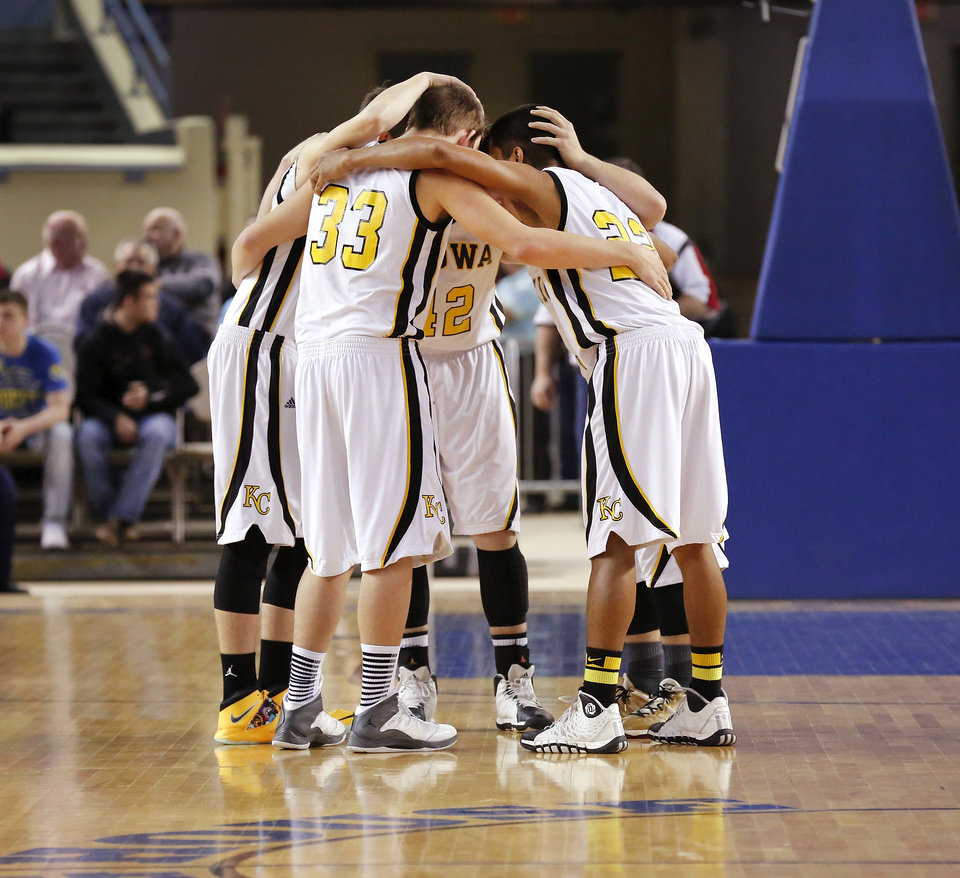 Photo - Kiowa starters huddle before the start of the  Class A boys high school basketball championship game in the Jim Norick Arena at State Fair Park on  Saturday, March 8, 2014. Glencoe defeated Kiowa, 57-39. Photo by Jim Beckel, The Oklahoman