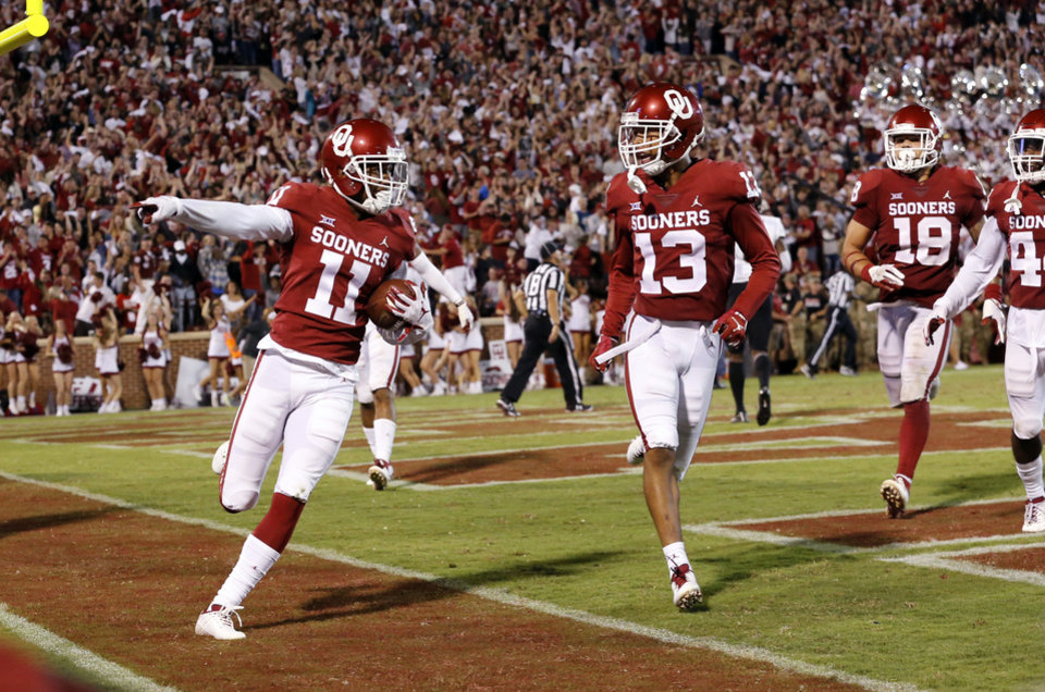 Photo - Oklahoma's Parnell Motley (11) celebrates a game ending interception in overtime during a college football game in which the University of Oklahoma Sooners (OU) defeated the Army Black Knights 28-21 at Gaylord Family-Oklahoma Memorial Stadium in Norman, Okla., on Saturday, Sept. 22, 2018. Photo by Steve Sisney, The Oklahoman