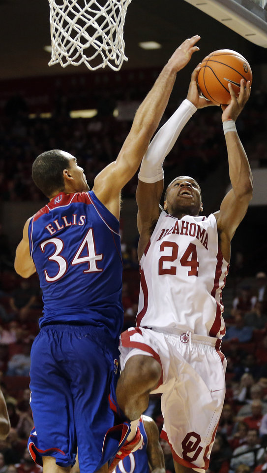 Photo - Oklahoma's Buddy Hield (24) goes to the basket against Kansas' Perry Ellis (34) during the NCAA college basketball game between the University of Oklahoma Sooners (OU) and the University of Kansas (KU) Jayhawks at Lloyd Nobel Center in Norman,  Okla. on Wednesday, Jan. 8, 2014.   .Photo by Chris Landsberger, The Oklahoman