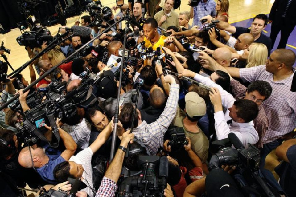 I swear, there\'s a Dwight Howard in there somewhere / (Reed Saxon/AP)