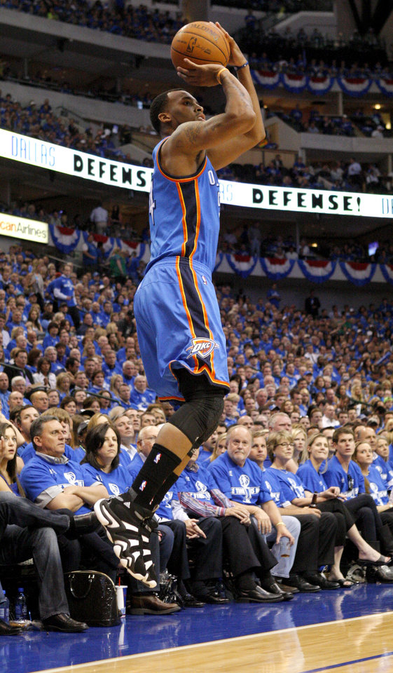 Oklahoma City's Daequan Cook (14) shoots the ball during Game 1 of the Western Conference Finals in the NBA basketball playoffs between the Dallas Mavericks and the Oklahoma City Thunder at American Airlines Center in Dallas, Tuesday, May 17, 2011. Photo by Bryan Terry, The Oklahoman ORG XMIT: KOD
