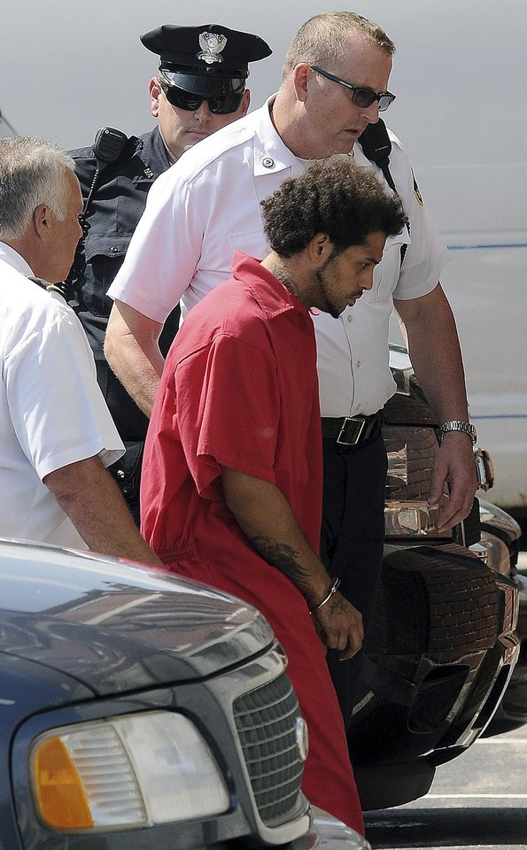 Photo - Carlos Ortiz is led into Attleboro District Court for his arraignment on weapons charges, Friday, June 28, 2013 in Attleboro, Mass. Ortiz was arrested Wednesday in Bristol, Conn., in connection with the murder case against former New England Patriots tight end Aaron Hernandez , now charged in the murder of Odin Lloyd.   (AP Photo/The Sun Chronicle, Mark Stockwell) MAGS OUT. MANDATORY CREDIT.