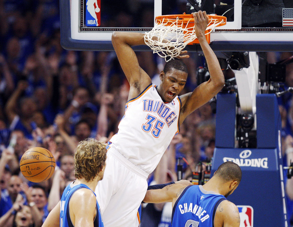 Oklahoma City's Kevin Durant (35) reacts after a dunk near Dirk Nowitzki (41) and Tyson Chandler (6) of Dallas in the second half during game 4 of the Western Conference Finals in the NBA basketball playoffs between the Dallas Mavericks and the Oklahoma City Thunder at the Oklahoma City Arena in downtown Oklahoma City, Monday, May 23, 2011. Dallas won in overtime, 112-105. Photo by Nate Billings, The Oklahoman