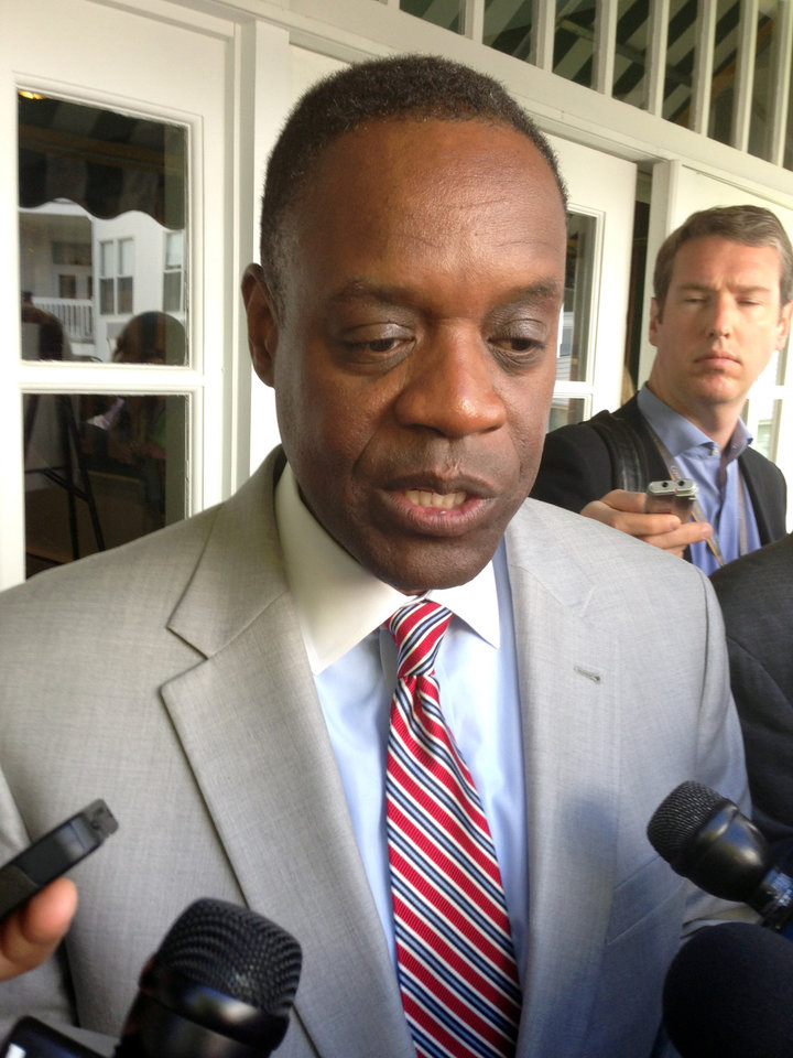 Photo - FILE - In a May 30, 2014 file photo, Detroit emergency manager Kevyn Orr speaks with reporters after addressing the Mackinac Policy Conference on Mackinac Island, Mich. In the little more than a year since Orr made Detroit the largest U.S. city to seek bankruptcy protection, it has experienced a wide range of improvements that will factor into Judge Steven Rhodes' decisions during next month's bankruptcy trial. A major piece of the bankruptcy puzzle could fall into place Monday, July 21, 2014, with the expected release of the results of a vote by creditors, including more than 30,000 retired and current city workers, on whether to accept millions of dollars in cuts. (AP Photo/David Eggert, File)