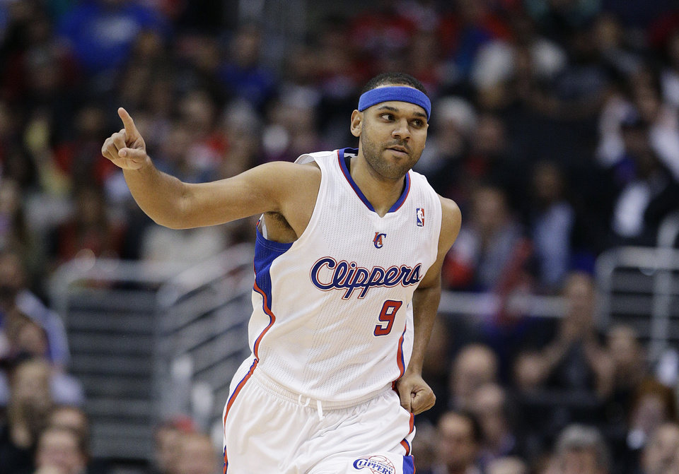 Los Angeles Clippers\' Jared Dudley reacts after making a three-point basket against the San Antonio Spurs during the first half of an NBA basketball game on Monday, Dec. 16, 2013, in Los Angeles. (AP Photo/Jae C. Hong)