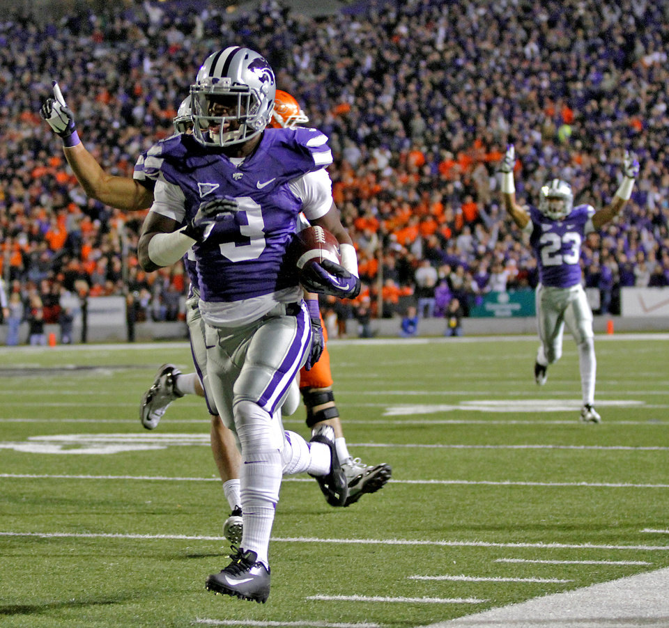 Photo - Kansas State's Allen Chapman (3) returns an interception for a touchdown during the college football game between the Oklahoma State University Cowboys (OSU) and the Kansas State University Wildcats (KSU) at Bill Snyder Family Football Stadium on Saturday, Nov. 1, 2012, in Manhattan, Kan. Photo by Chris Landsberger, The Oklahoman