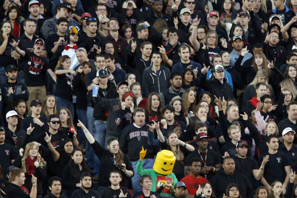 A Lego man cheers during the college football game between the Oklahoma State Cowboys (OSU) and the Texas Tech Red Raiders (TTU) at Jones AT&T Stadium in Lubbock, Texas, Saturday, Nov. 2, 2013. Photo by Sarah Phipps, The Oklahoman