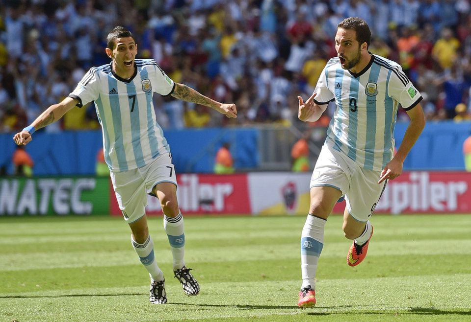 Photo - Argentina's Gonzalo Higuain, right, celebrates with Angel di Maria after scoring the opening goal during the World Cup quarterfinal soccer match between Argentina and Belgium at the Estadio Nacional in Brasilia, Brazil, Saturday, July 5, 2014. (AP Photo/Martin Meissner)