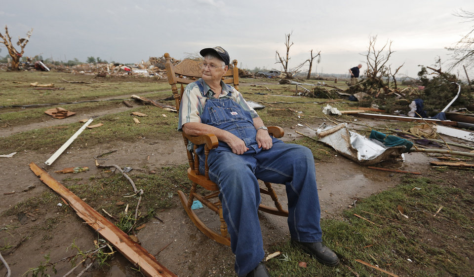 Gene Tripp sits in his rocking chair where his home once stood after being destroyed by a tornado hit the area near 149th and Drexel on Monday, May 20, 2013 in Oklahoma City, Okla.  Photo by Chris Landsberger, The Oklahoman