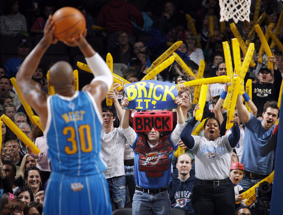 Photo - Oklahoma City fans try to distract David West (30) of New Orleans as he takes a foul shot during the NBA basketball game between the New Orleans Hornets and the Oklahoma City Thunder at the Ford Center in Oklahoma City, Wednesday, March 10, 2010. Oklahoma City won, 98-83. Photo by Nate Billings, The Oklahoman ORG XMIT: KOD