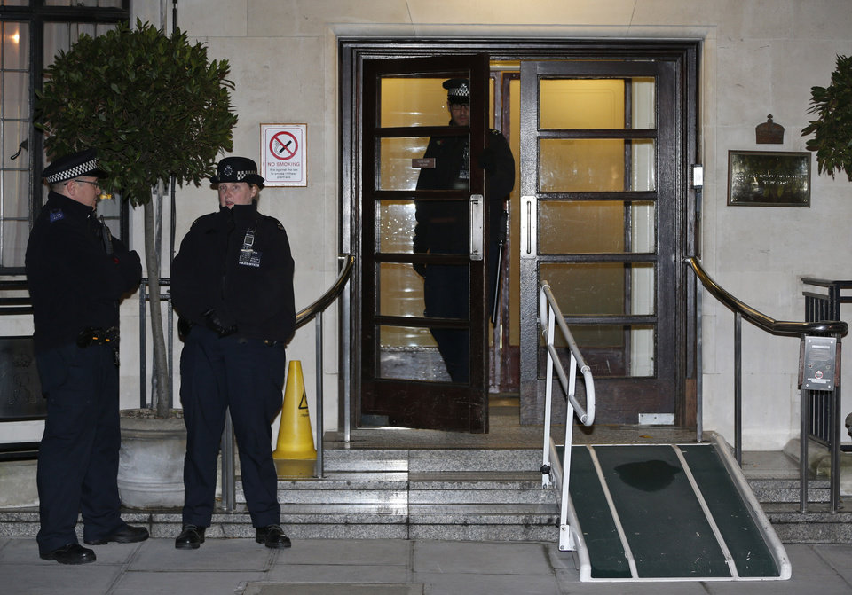 Photo - Police officers stand guard outside the King Edward VII hospital,  in central London, Friday, Dec.  7, 2012.  King Edward VII hospital says a nurse involved in a prank telephone call to elicit information about the Duchess of Cambridge has died. The hospital said Friday that Jacintha Saldanha had been a victim of the call made by two Australian radio disc jockeys. They did not immediately say what role she played in the call.  (AP Photo/Lefteris Pitarakis)