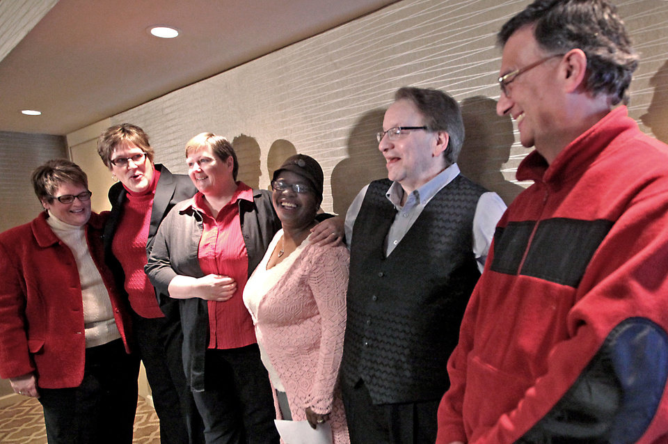 Photo - FILE - In this Feb. 3, 2014 file photo, plaintiffs in a federal lawsuit challenging Wisconsin's ban on gay marriage, from left:  Judi Trampf and Katy Heyning of Madison; Marie Carlson and Charvonne Kemp of Milwaukee, and Garth Wangemann and Roy Badger of Milwaukee, appear during a news conference in Madison, Wis. The issue of health care crises involving gay and lesbian couples, like those experienced by Heyning and Wangemann during hospital emergencies, looms large in a combined legal case targeting Indiana and Wisconsin's gay marriage bans that's set for oral arguments Tuesday, Aug. 26, 2014, before a federal appeals court in Chicago. (AP Photo/State Journal, John Hart, File)