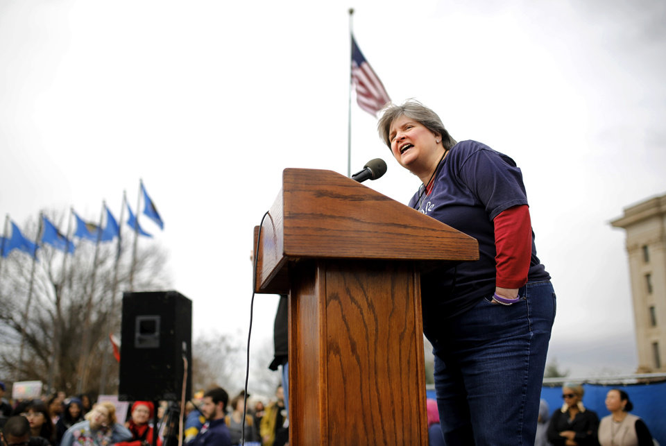 Photo - Sharon Bishop Baldwin, Tulsa, speaks to the crowd. A crowd estimated by organizers to be as many as 7,000 people came to the state Capitol in Oklahoma City Saturday, Jan. 21, 2017, to rally, using their voices and signs to express displeasure with the nation's new administration as part of a larger network of marches taking place across the country following Donald Trump's inauguration.   The Women's March on Oklahoma included a walk along Lincoln Blvd., with the Capitol as a backdrop, and a rally on the Capitol's south plaza that featured nearly a dozen speakers.  Photo by Jim Beckel, The Oklahoman