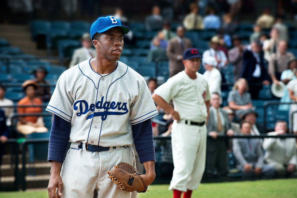 Photo - This film image released by Warner Bros. Pictures shows Chadwick Boseman as Jackie Robinson in a scene from