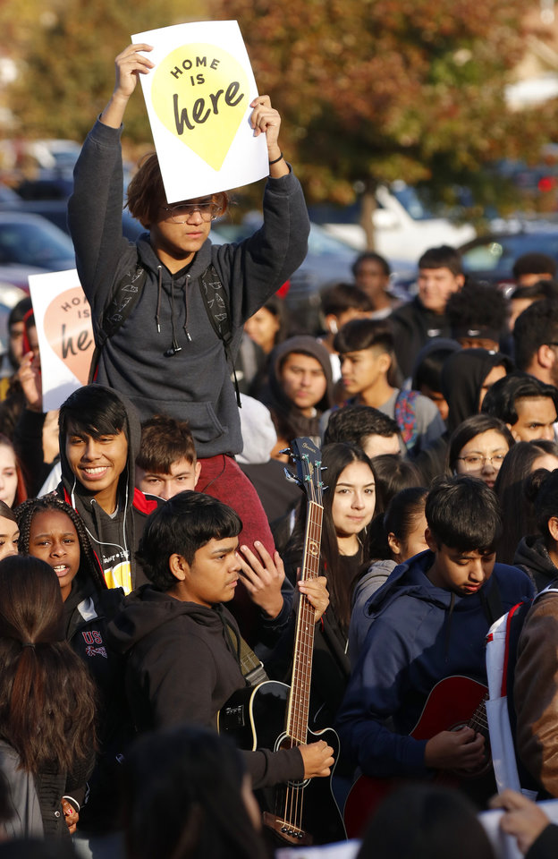 "Photo - A student holds a ""Home id Here"" sign during the DACA support rally at U.S. Grant High School Friday, November 8, 2019. Photo by Doug Hoke"