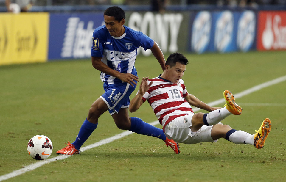 Photo - Honduras' Andy Najar (14) pulls down United States' Jose Torres (16) during the first half of the Gold Cup semifinals at Cowboys Stadium, Wednesday, July 24, 2013, in Arlington, Texas. (AP Photo/Brandon Wade)