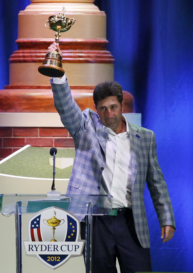 Photo - European team captain Jose Maria Olazabal holds up the trophy at the closing ceremony at the Ryder Cup PGA golf tournament Sunday, Sept. 30, 2012, at the Medinah Country Club in Medinah, Ill. (AP Photo/Charles Rex Arbogast)  ORG XMIT: PGA251