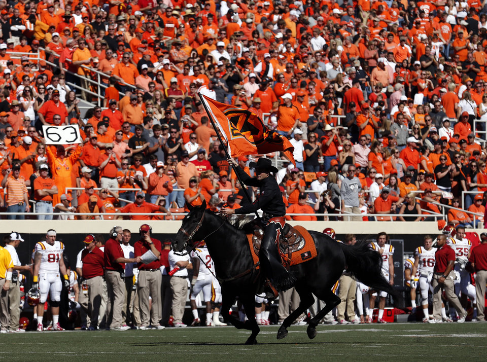 Photo - Bullet celebrates a Cowboy touchdown during a college football game between Oklahoma State University (OSU) and Iowa State University (ISU) at Boone Pickens Stadium in Stillwater, Okla., Saturday, Oct. 20, 2012. Photo by Sarah Phipps, The Oklahoman