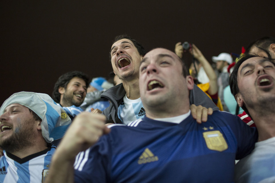 Photo - Argentina fans celebrate after their team defeated the Netherlands during a World Cup semifinal soccer match at the Itaquerao Stadium in Sao Paulo Brazil, Wednesday, July 9, 2014. Argentina made it to the World Cup final with a 4-2 shootout win over the Netherlands after the game finished in a 0-0 stalemate. (AP Photo/Felipe Dana)