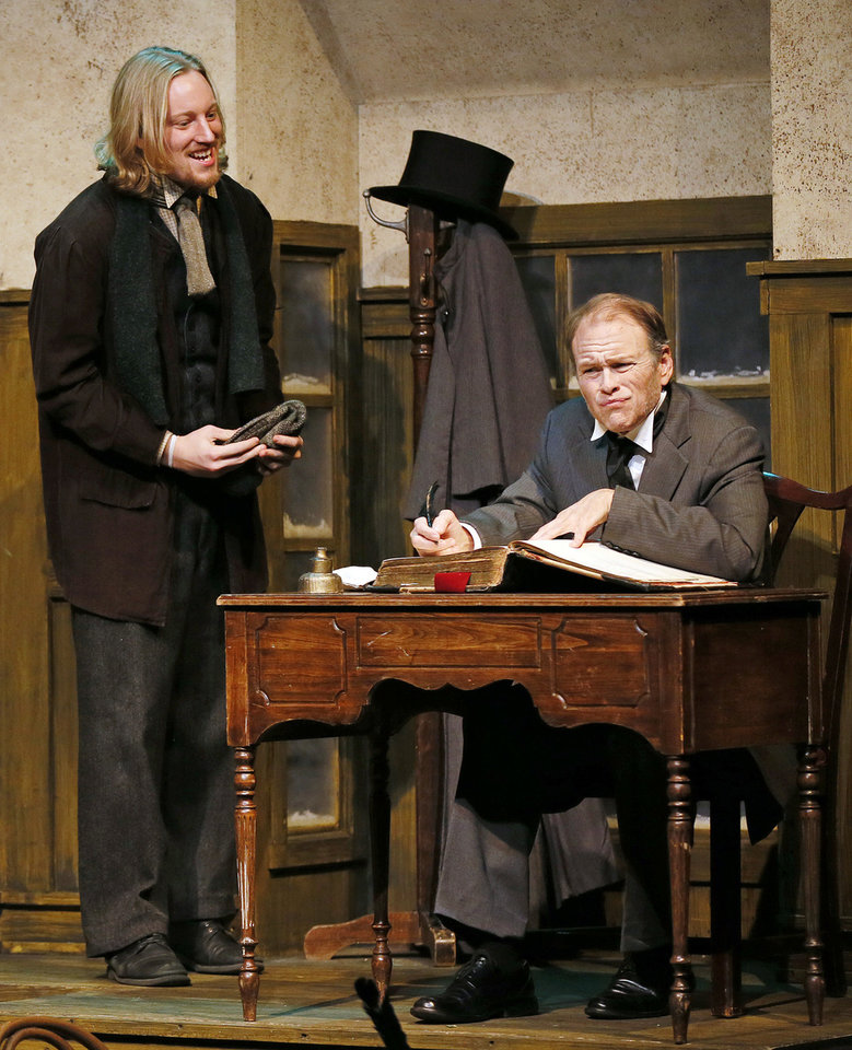 "Right: Parker Wilmoth as Bob Cratchit, left, and Mike Waugh as Scrooge perform during a dress rehearsal in the Burg Theater for Oklahoma Children�s Theatre and TheatreOCU�s production of ""A Christmas Carol"" at Oklahoma City University."